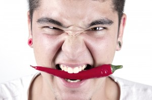red hot chilly pepper in mouth