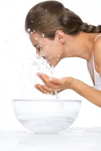 young-woman-washing-face