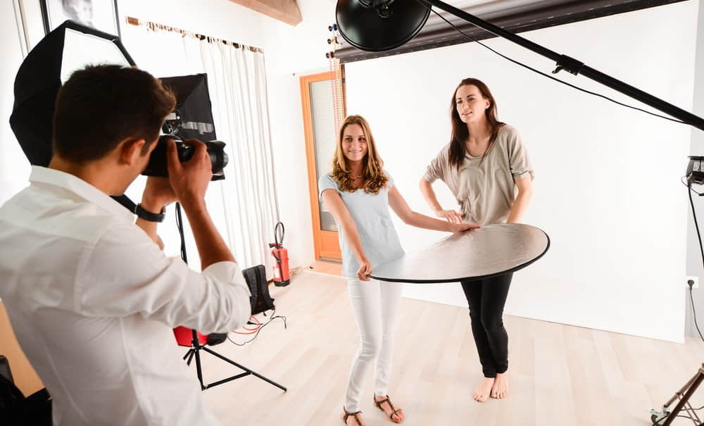 A reflector is a tool that helps a photographer to manipulate the light